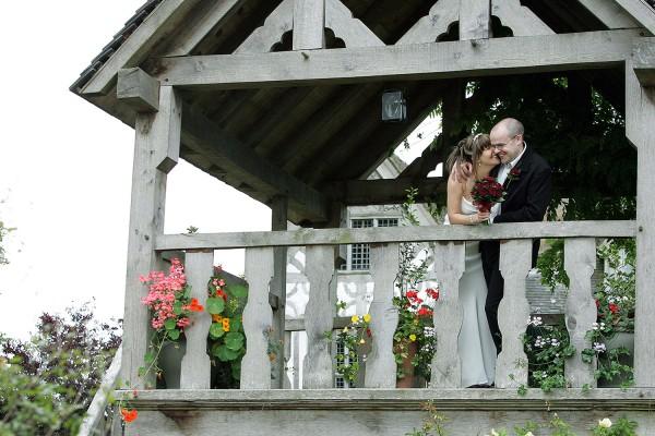 11_bride_groom_ceremony_tree_house_old_colehurst_manor_shropshire_wedding_photographer_0011